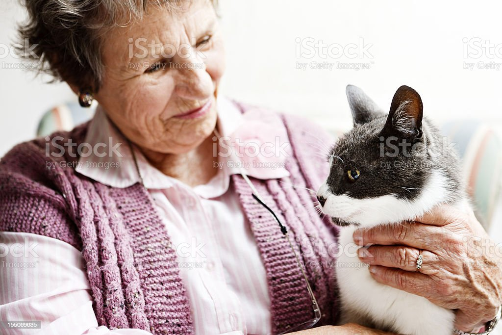 Old lady and her beloved cat, best friends forever! royalty-free stock photo