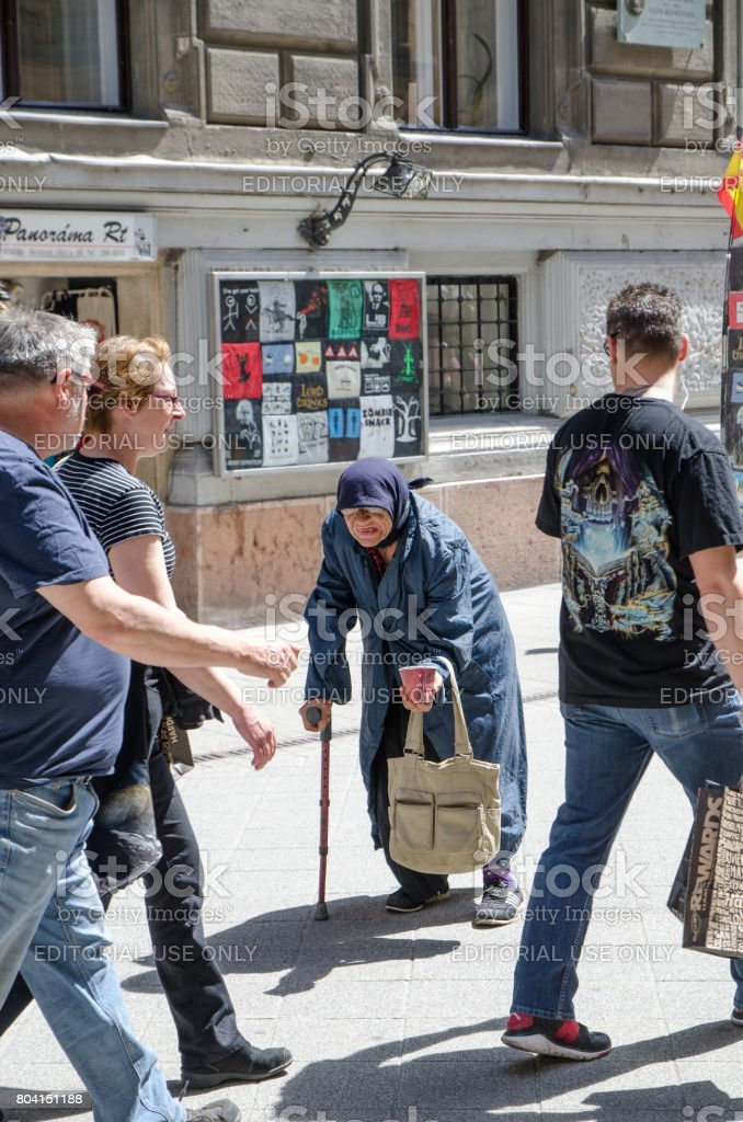 Old lady begging in the tourist area of Budapest during summer day stock photo