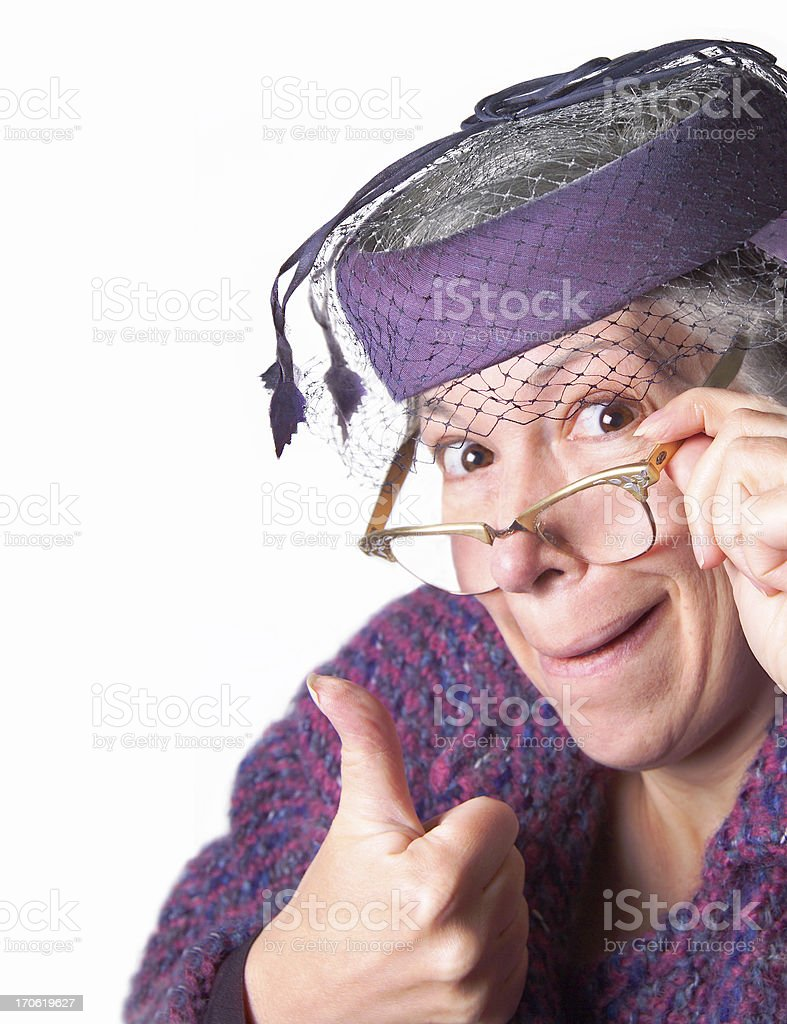 old lady giving the thumbs up sign stock photo