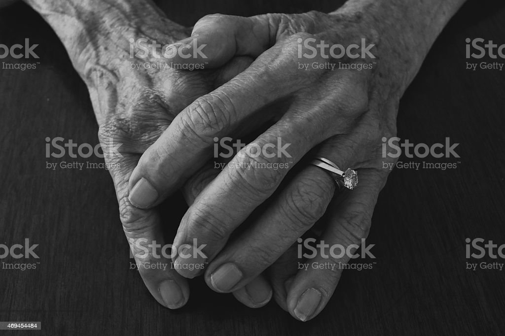old lady hands with solitaire diamond ring stock photo