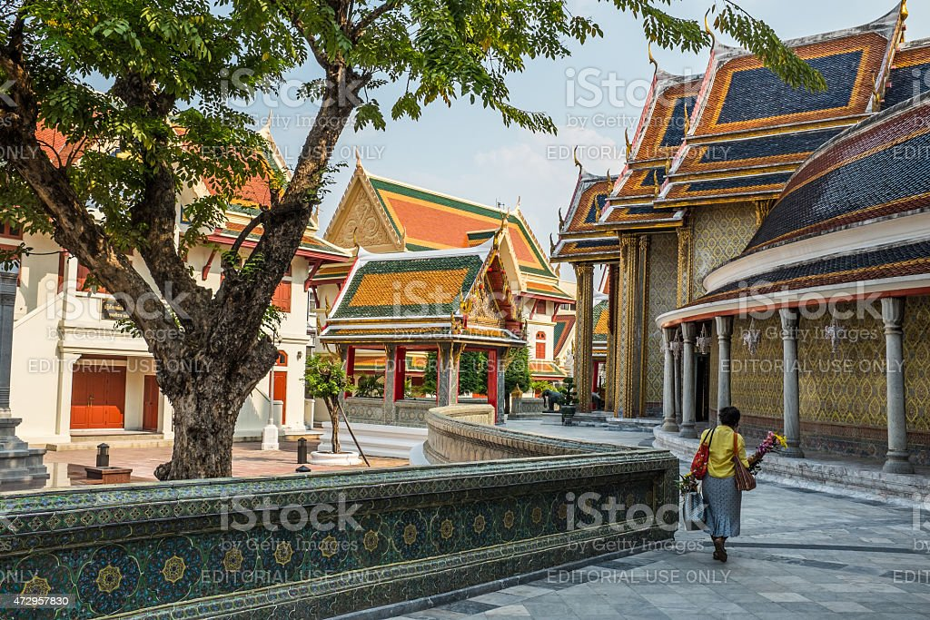 Old lady in a temple in Thailand stock photo