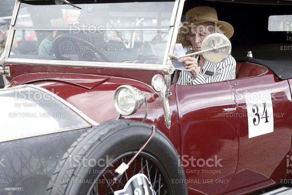 Old lady in vintage Rolls Royce royalty-free stock photo