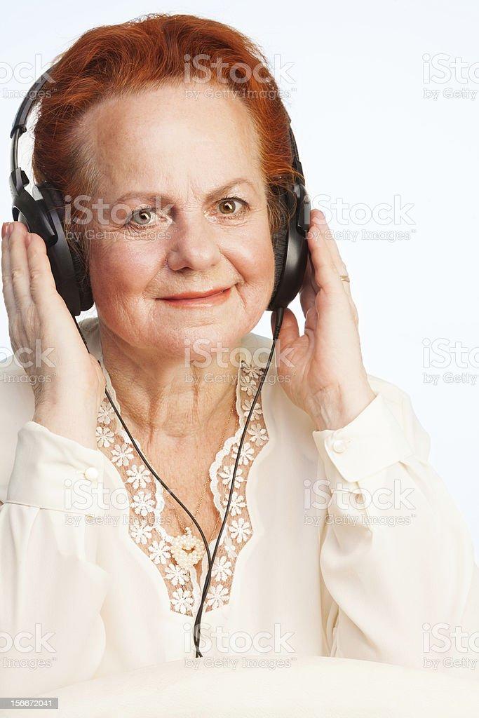 Old lady listening to music royalty-free stock photo