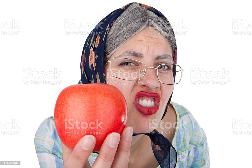 Old Lady Offering Apple royalty-free stock photo