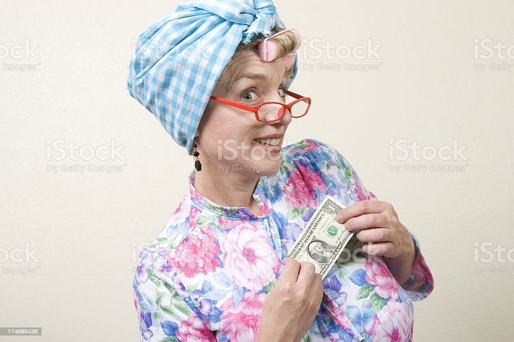 Old Lady Pulling Dollar Bill from Night Gown - Profile royalty-free stock photo