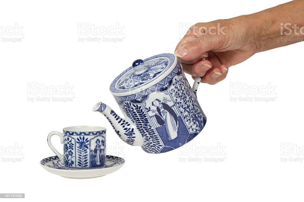 Old lady with an antique Dutch teapot and cup stock photo