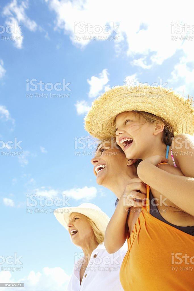 Old lady with girl enjoying a piggyback ride on mother royalty-free stock photo