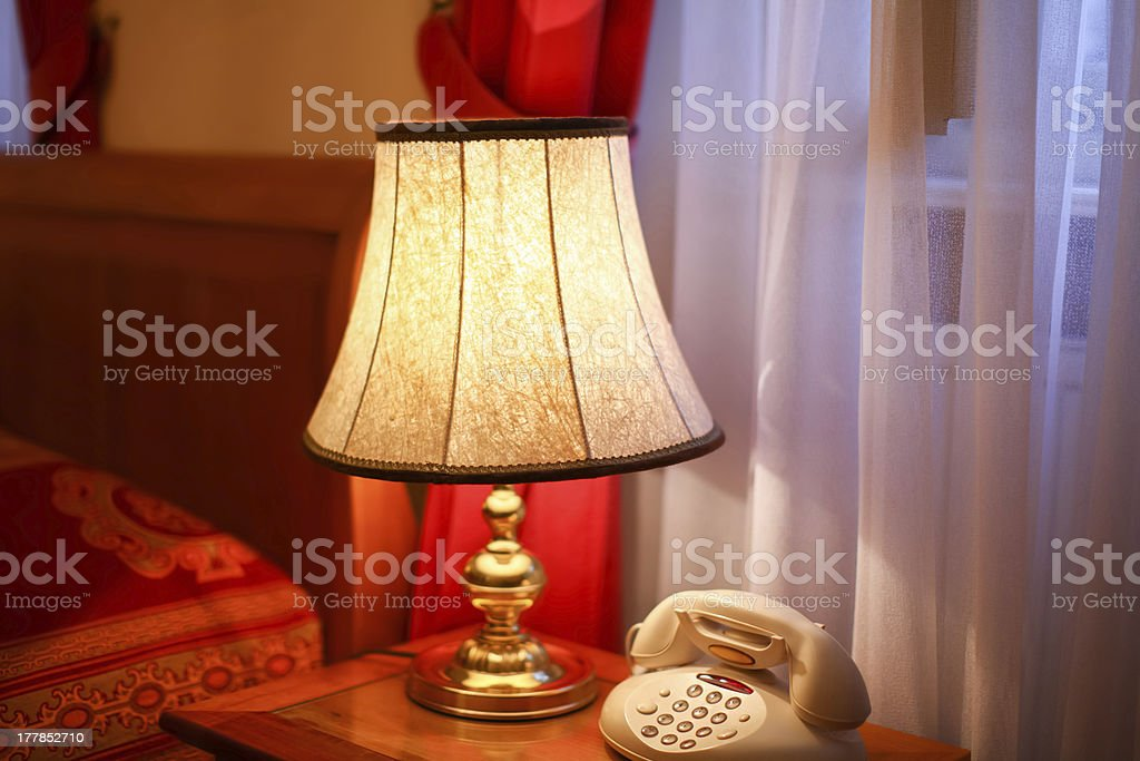 Old lamp and telephone in retro style royalty-free stock photo