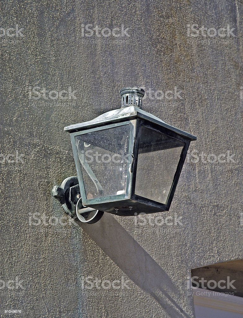 Old Lamp on Contrete Wall royalty-free stock photo