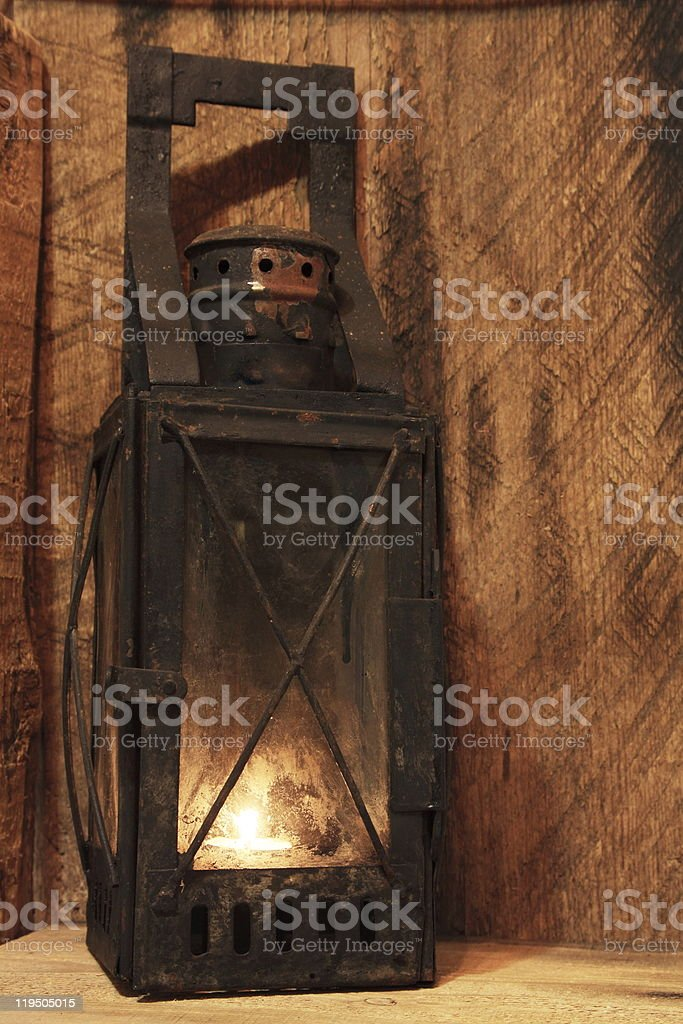 Old lamp with lighted candle stock photo