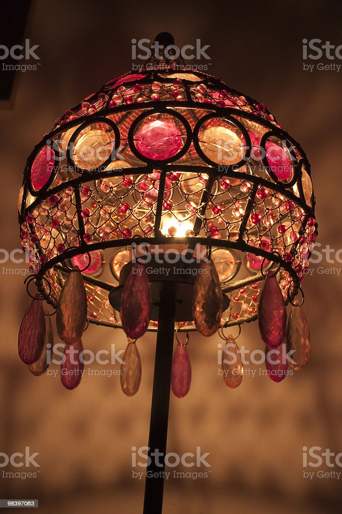 Old lamps, and colored glass candle stock photo