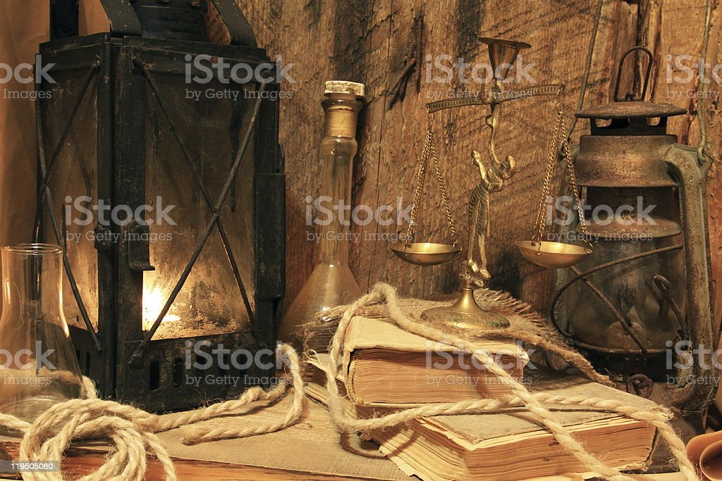 Old lamps, books and balance royalty-free stock photo