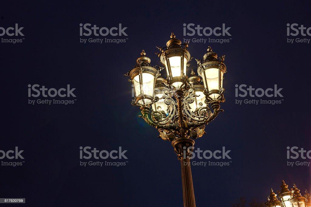 old lantern by night stock photo