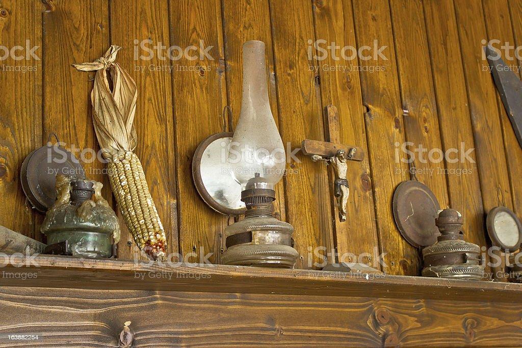 Old lantern, crucifixion, corncob and paraffin lamp royalty-free stock photo