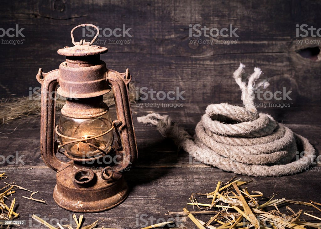 Old lantern on wooden background stock photo