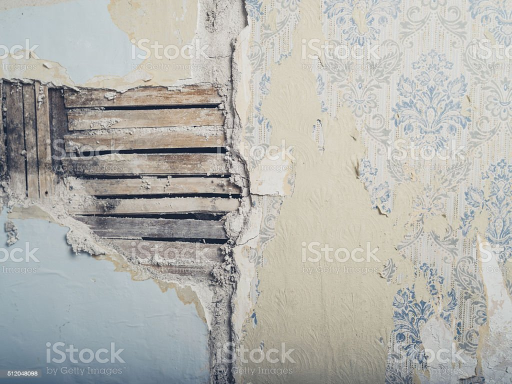 Old lath and plaster wall stock photo