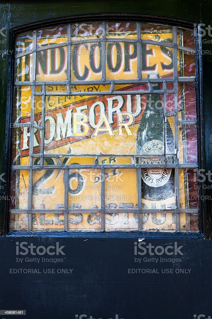 old leaded window advertising bottled beer royalty-free stock photo