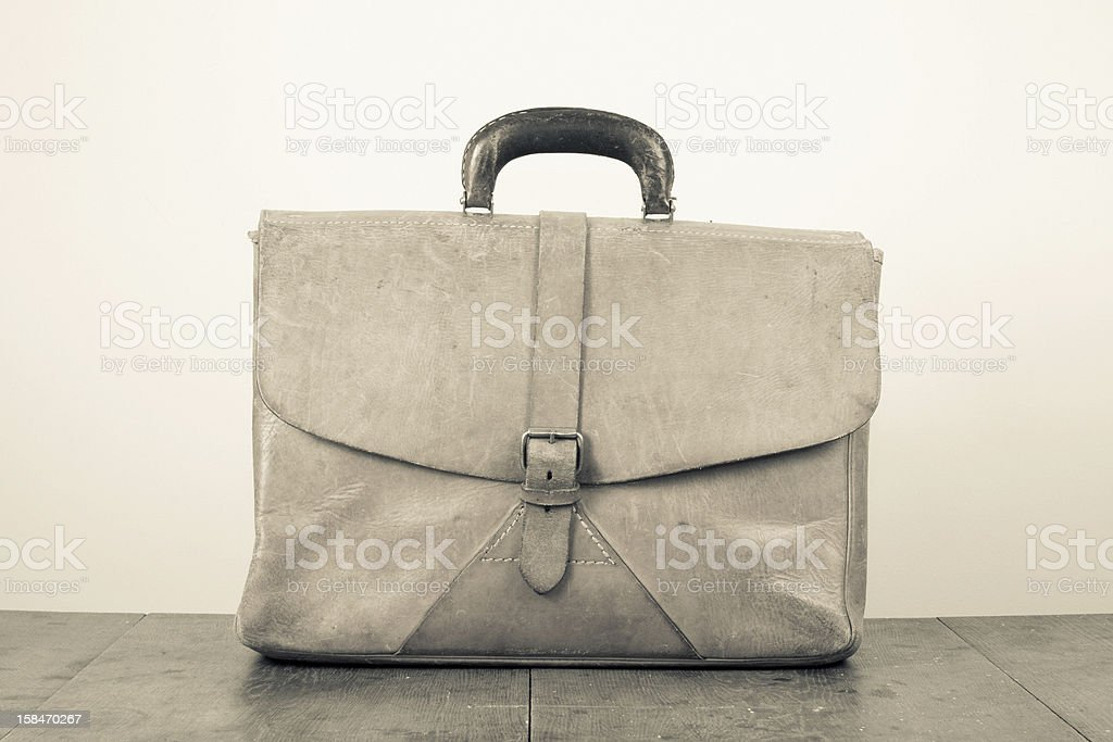 Old leather bag on wood stock photo