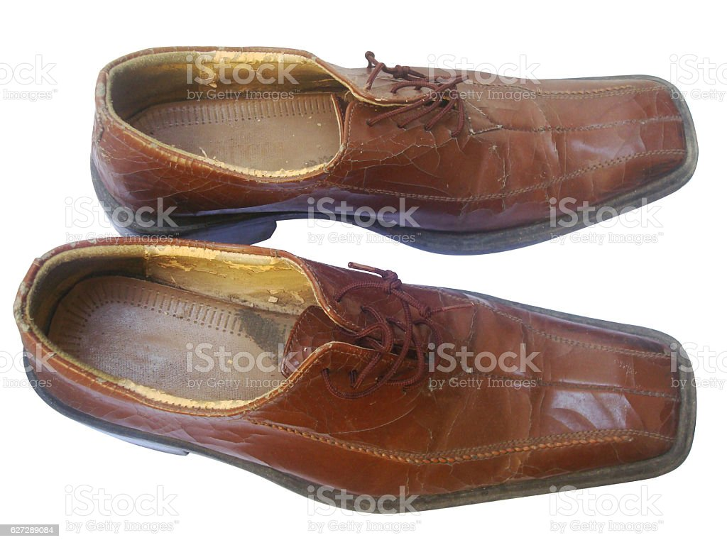 Old leather brown shoes stock photo