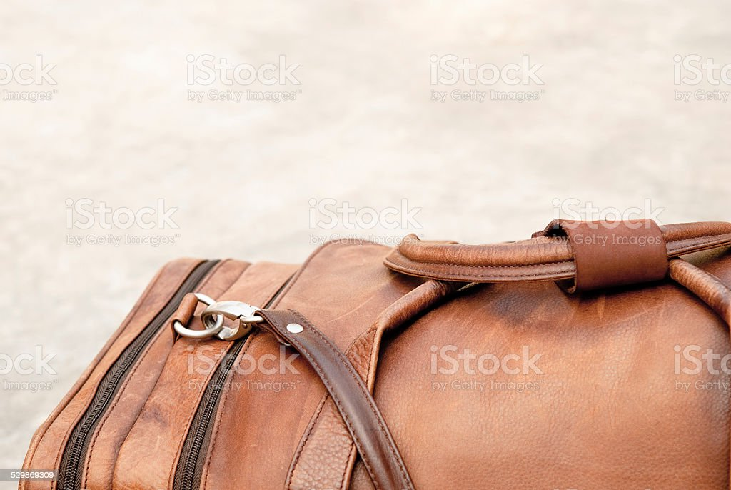 Old leather duffle bag stock photo
