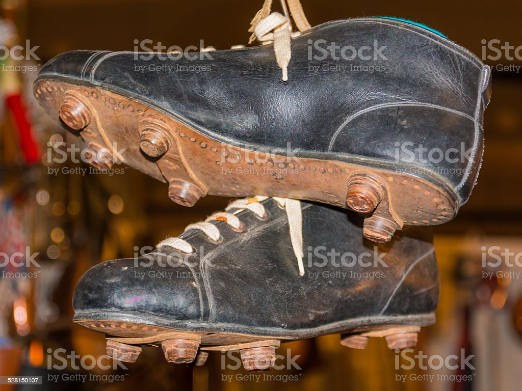 Old leather hanged soccer boots stock photo