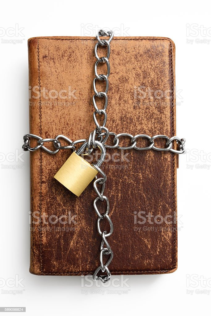Old leather personal organizer with locked padlock on white background stock photo