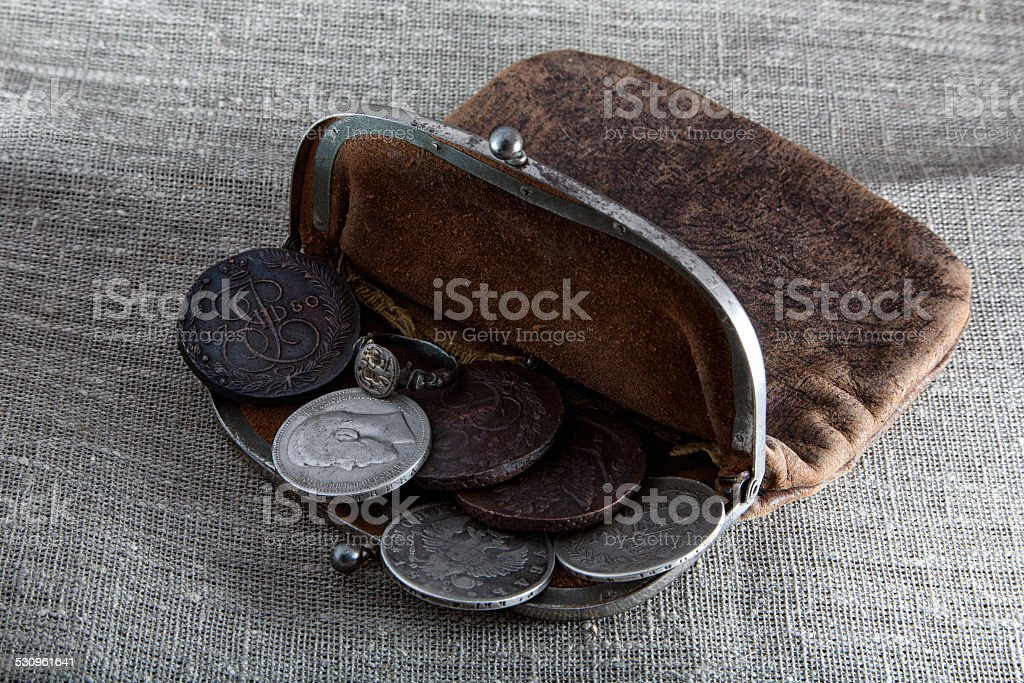 Old leather purse with coins stock photo