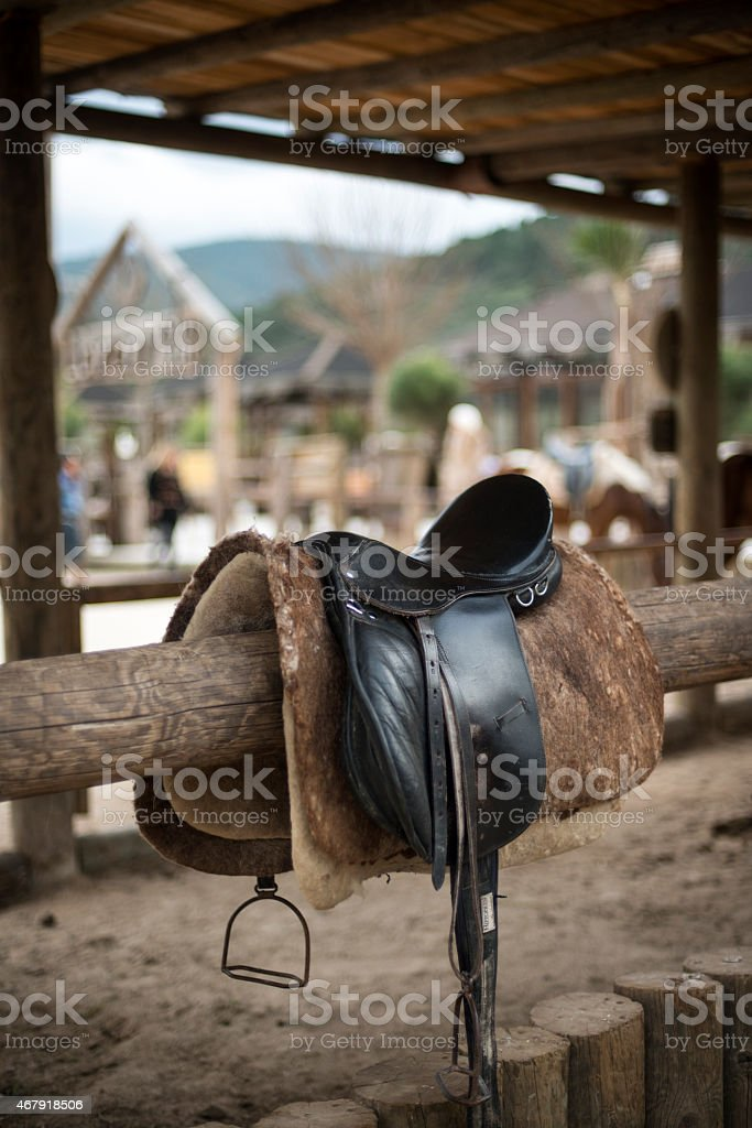 Old leather saddle stock photo