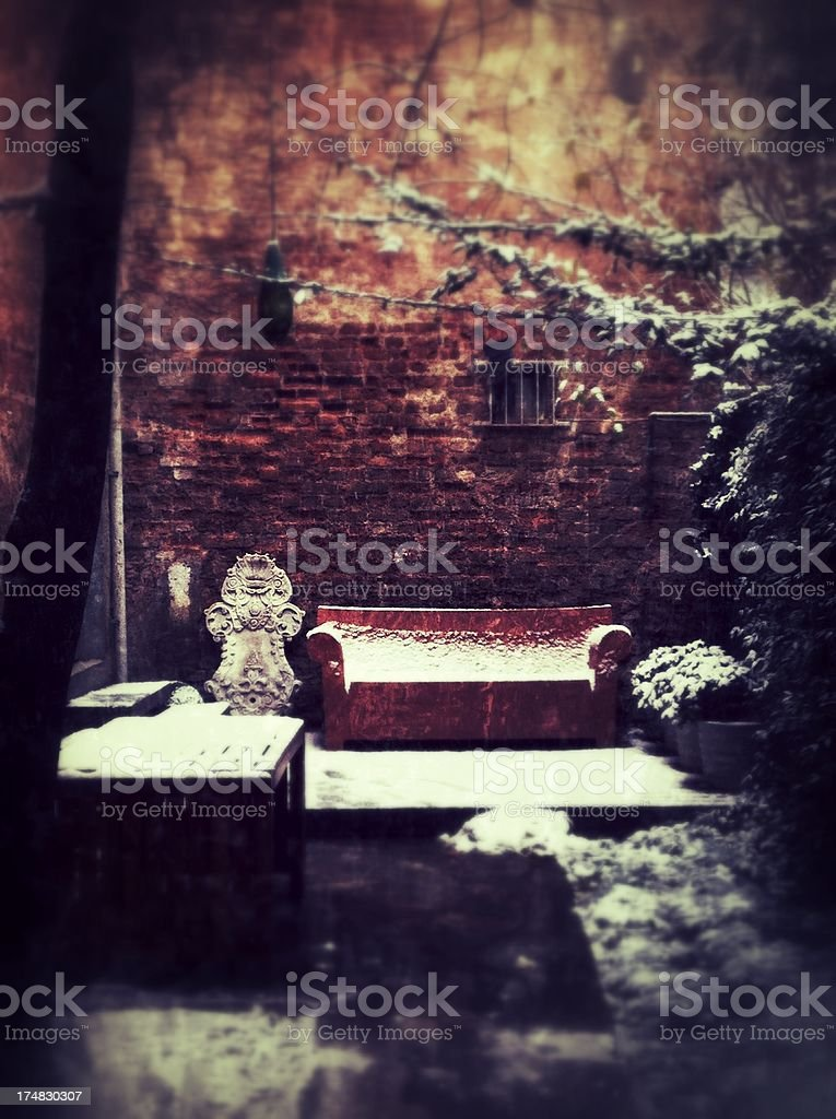Old leather seat abandoned in the snow, Istanbul, Turkey royalty-free stock photo