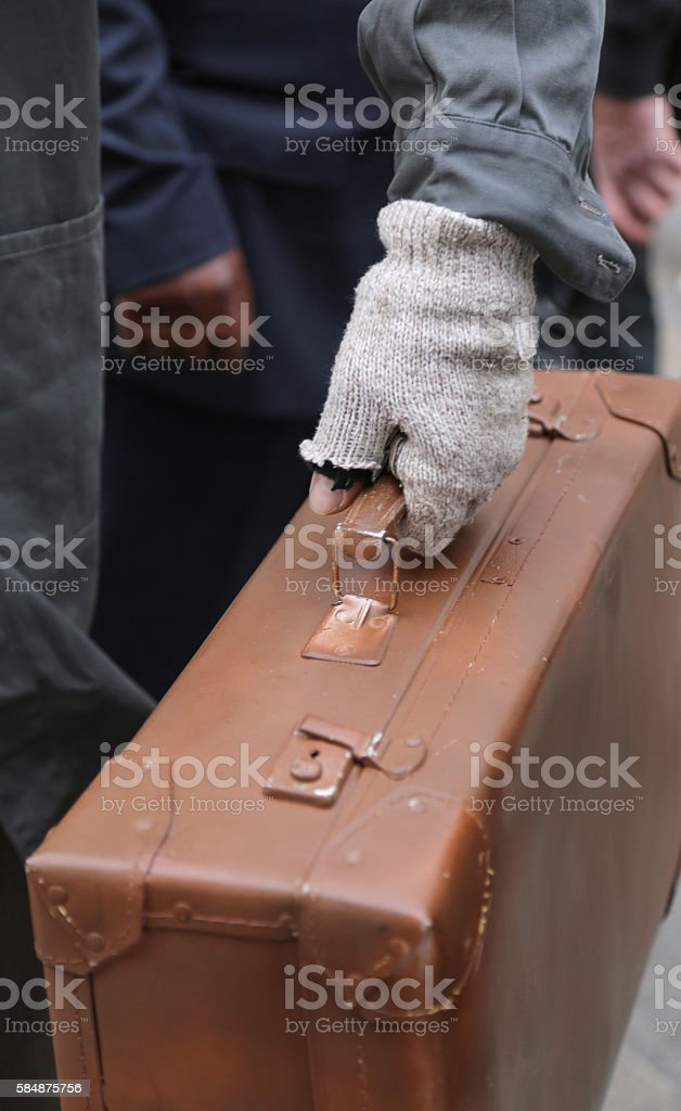 old leather suitcase and the broken glove stock photo