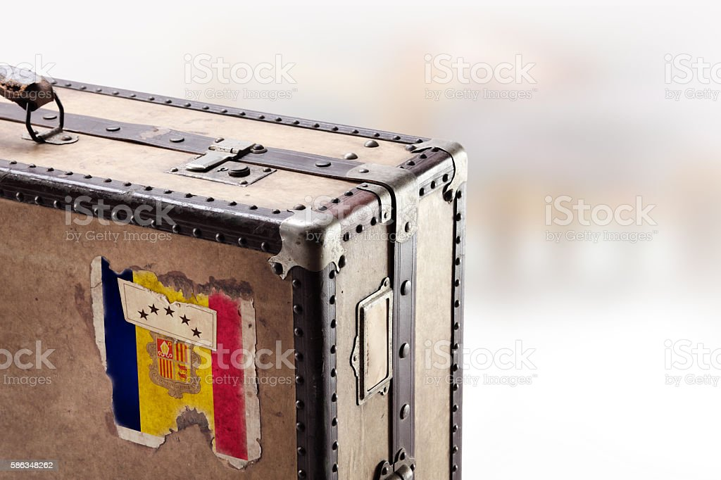 Old leather suitcase with flag of Andorra stock photo