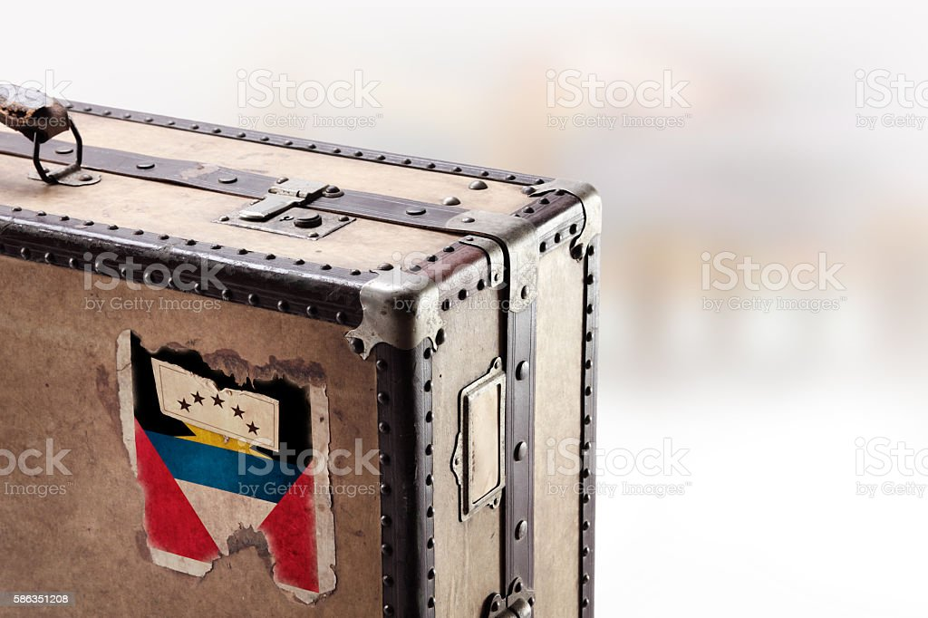 Old leather suitcase with flag of Antigua and Barbuda stock photo
