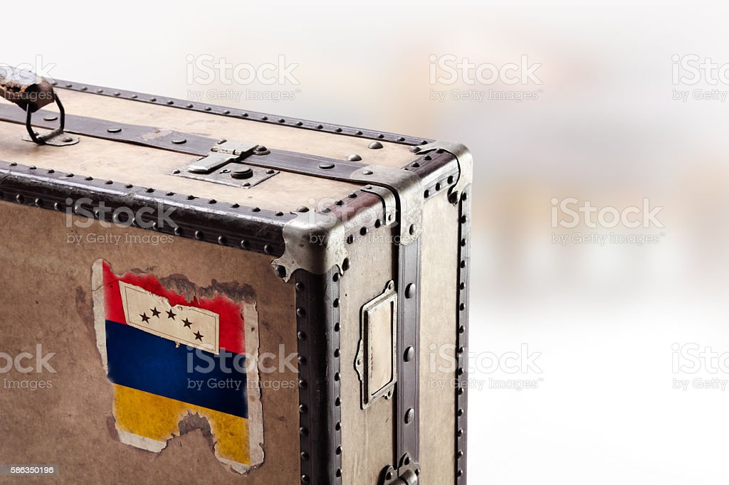 Old leather suitcase with flag of Armenia stock photo