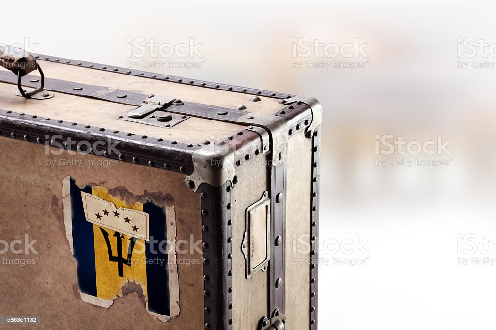 Old leather suitcase with flag of Barbados stock photo