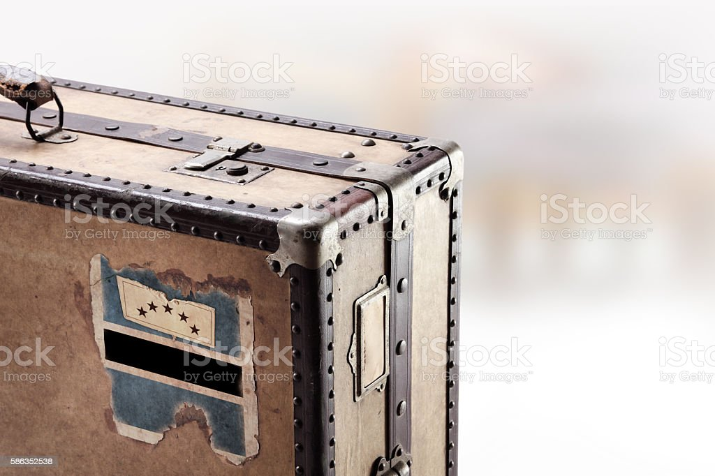 Old leather suitcase with flag of Botswana stock photo