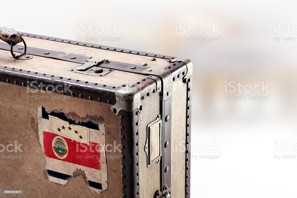 Old leather suitcase with flag of Costa Rica stock photo