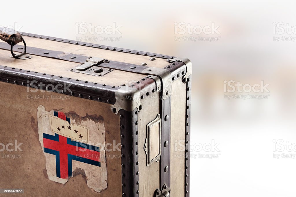 Old leather suitcase with flag of Faroe Islands stock photo