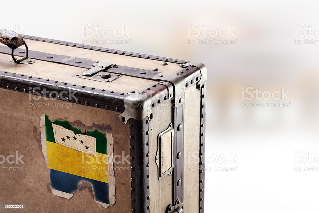 Old leather suitcase with flag of Gabon stock photo