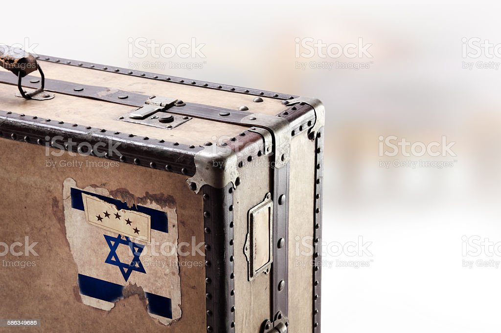 Old leather suitcase with flag of Israel stock photo