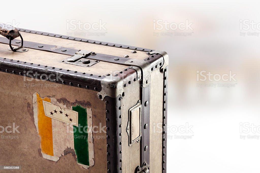 Old leather suitcase with flag of Ivory Coast stock photo