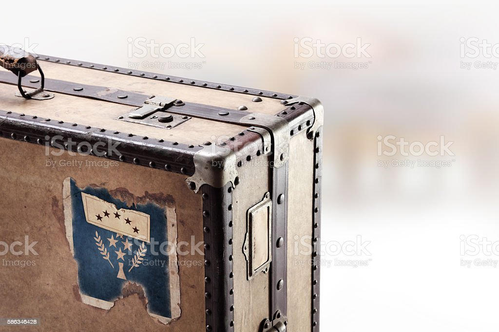 Old leather suitcase with flag of Kosrae stock photo