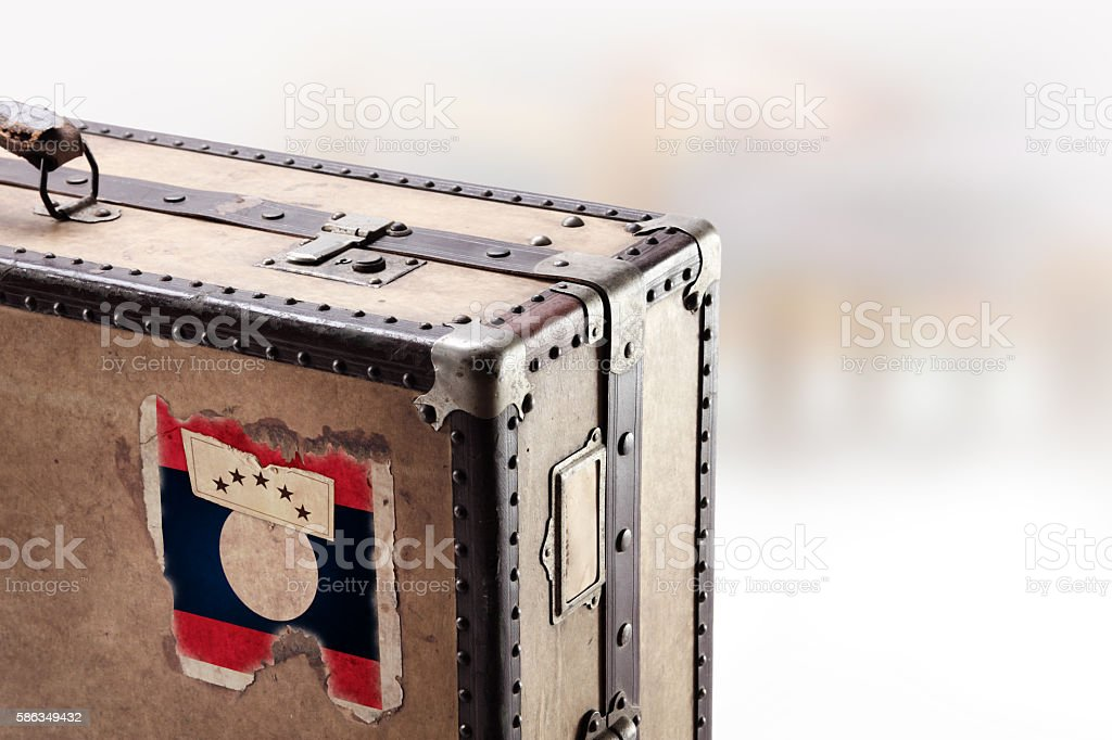 Old leather suitcase with flag of Laos stock photo