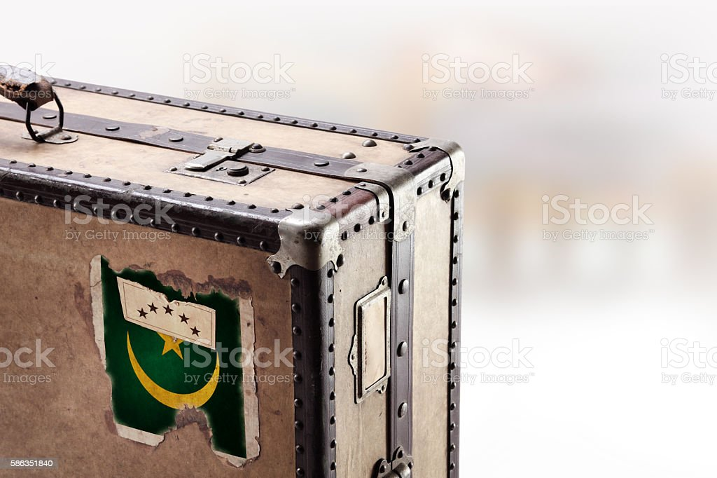Old leather suitcase with flag of Mauritania stock photo