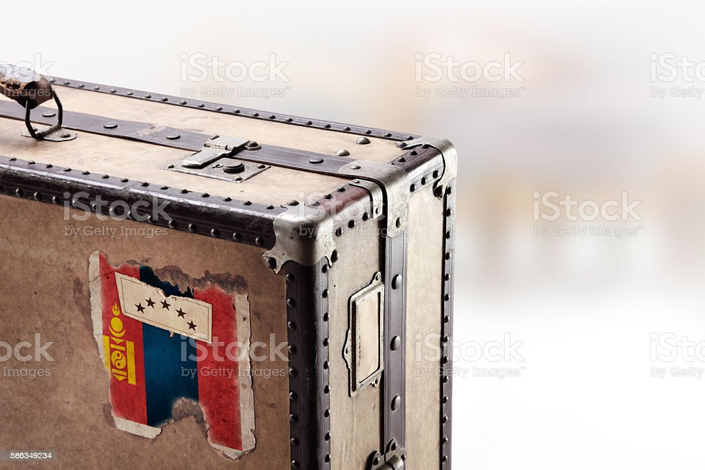 Old leather suitcase with flag of Mongolia stock photo