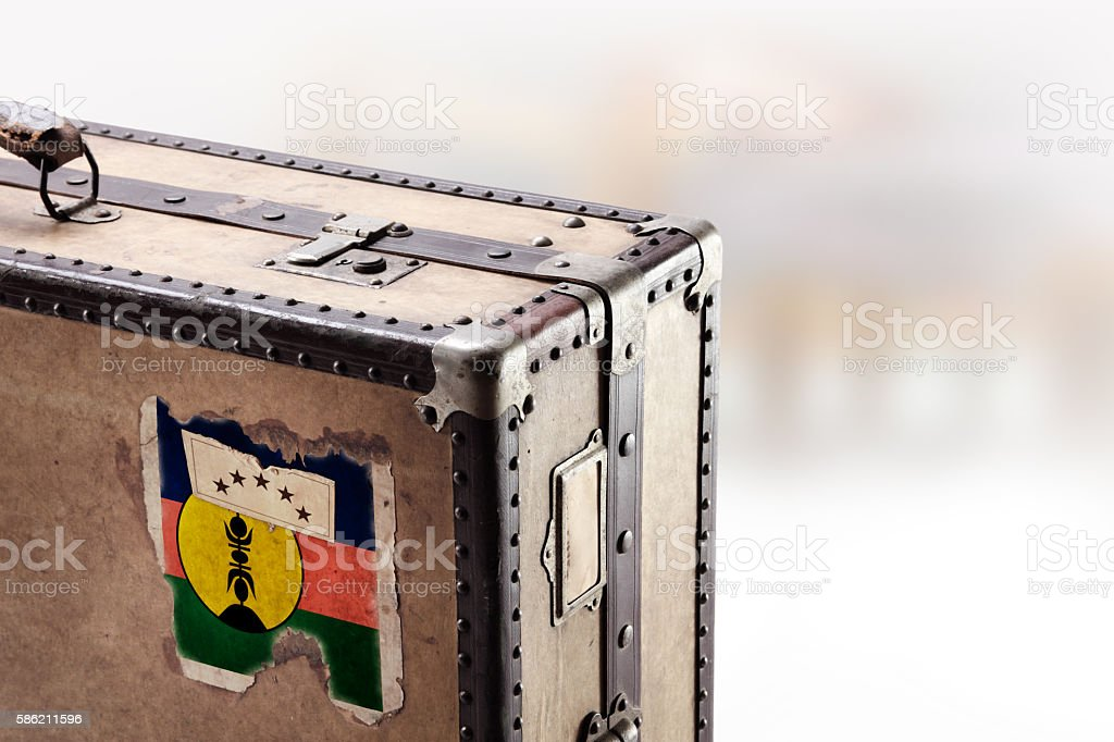 Old leather suitcase with flag of New Caledonia stock photo