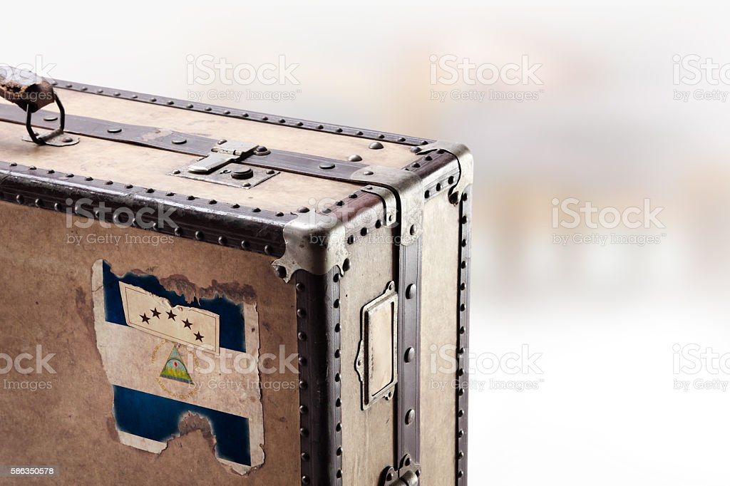 Old leather suitcase with flag of Nicaragua stock photo