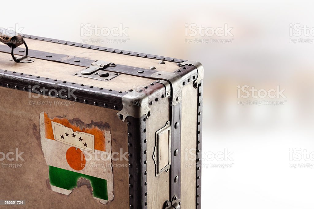 Old leather suitcase with flag of Niger stock photo