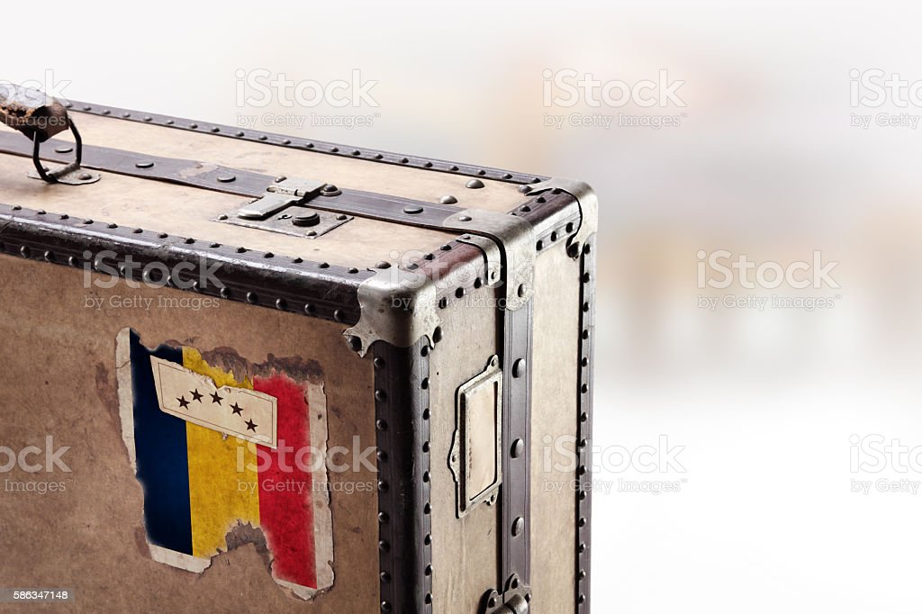 Old leather suitcase with flag of Romania stock photo