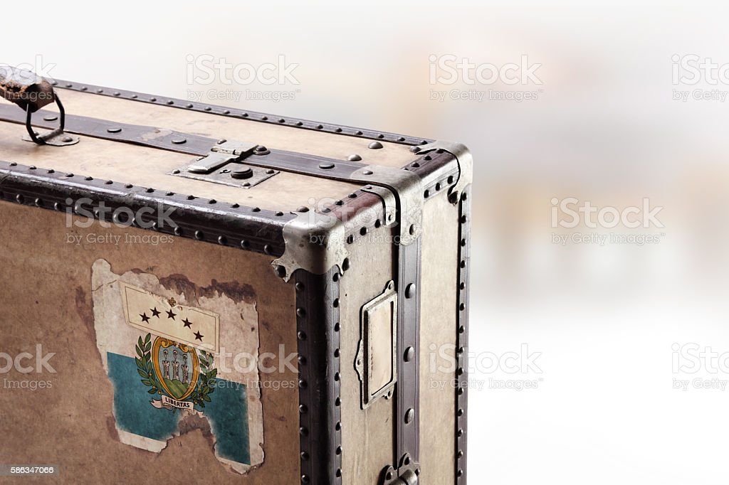 Old leather suitcase with flag of San Marino stock photo