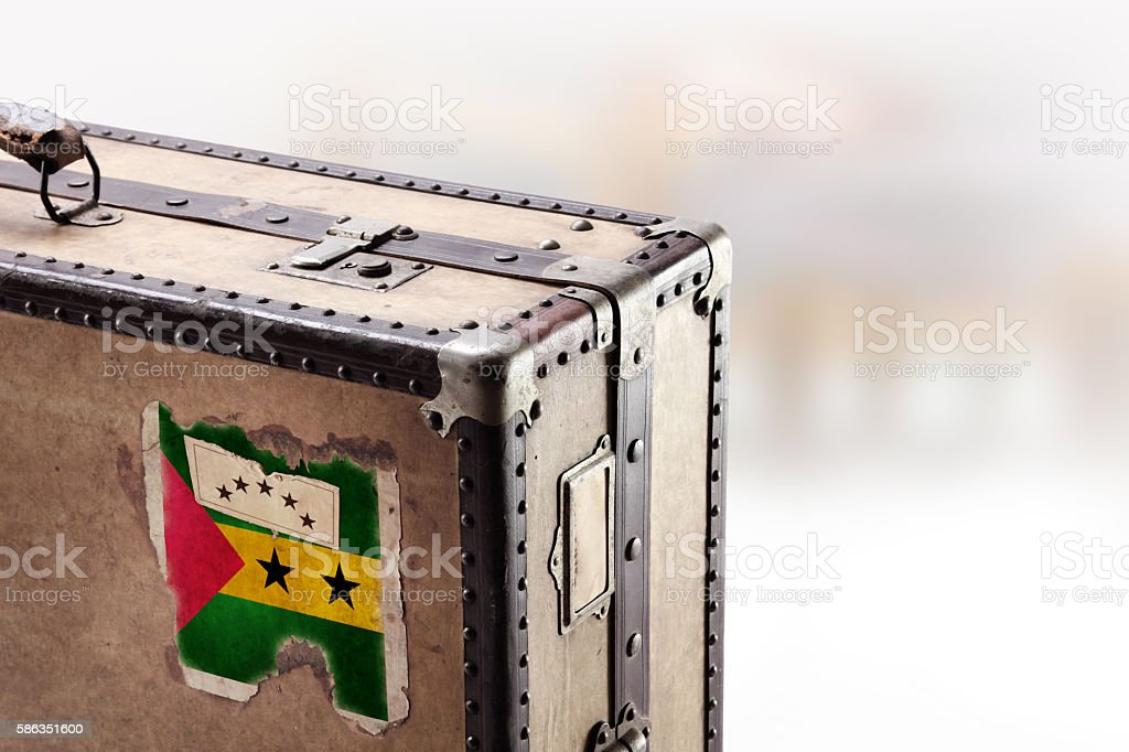 Old leather suitcase with flag of Sao Tome stock photo